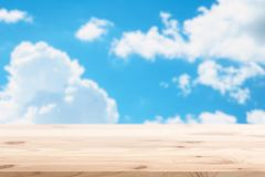 Blue summer sky cloud background with wood floor royalty free stock photos