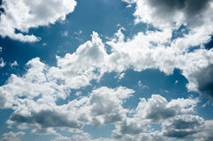 Blue summer sky with curvy clouds, background,void Stock Photo