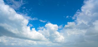 Blue summer sky white cumulus clouds. Background stock photo