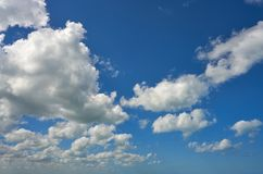 Blue summer sky white cumulus clouds. Background Stock Images