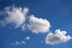 Blue summer sky white cumulus clouds. Background Royalty Free Stock Photo