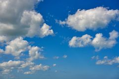 Blue summer sky white cumulus clouds. Background Stock Photos