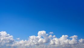 Blue summer sky white cumulus clouds. Background Stock Image