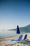 Blue summer umbrella with two chairs on blue sky Stock Photo