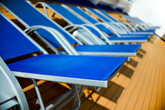 Blue sun beds Royalty Free Stock Image