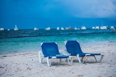 Blue sun beds on a tropical beach. Blue sunbeds on a tropical beach, clean ocean and sand, great beach Stock Images