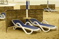 Blue sun loungers on the beach. Stock Image