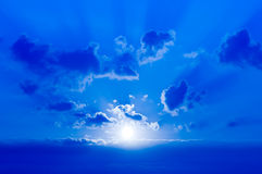 Blue sun rising Royalty Free Stock Images