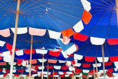 Blue sun umbrellas Stock Image