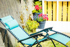 Free Blue Sunbed Deck Chair In Garden Stock Image - 98414141