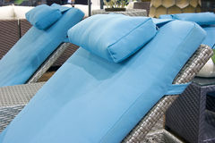 Blue sunbeds stock photography