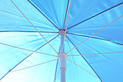 Blue sunblock umbrella Royalty Free Stock Photography