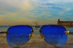 Blue Sunglasses With Black-frame on Concrete Stone Royalty Free Stock Images