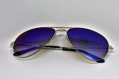 Blue sunglasses stock photo