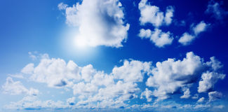 Blue sunny sky with clouds Royalty Free Stock Image