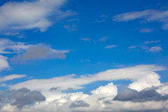 Blue sunny sky white clouds Stock Image