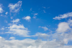 Blue sunny sky white clouds Royalty Free Stock Image
