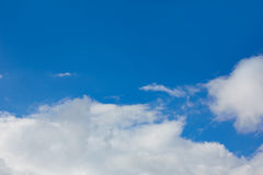 Blue sunny sky white clouds Stock Photos