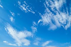 Blue sunny sky with white clouds royalty free stock photo