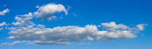 Blue sunny sky with white clouds landscape banner royalty free stock photos