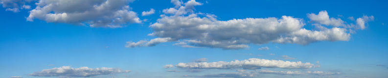 Blue sunny sky with white clouds landscape banner stock photo