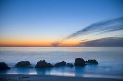 Blue sunrise on the beach stock photography