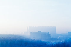 Blue sunrise sky over city in cold winter Royalty Free Stock Images