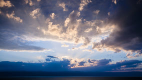Blue sunset clouds over Dead Sea in winter evening Stock Photography