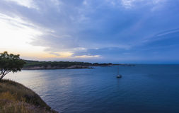 Blue sunset in Rosas bay, Costa Brava, Spain. Royalty Free Stock Images