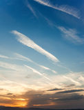 Blue sunset sky with clouds. Beautiful sky background royalty free stock image