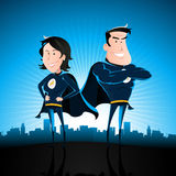 Blue Superhero Man And Woman. Illustration of a cartoon couple of superhero man and woman standing proudly with star burst shining and cityscape behind Stock Photography
