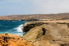 Blue Surf on Rocky Aruba Beach Stock Photography