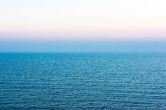 Blue surface of sea and evening sky Royalty Free Stock Photos