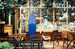 Blue Surfboard Leaning on Desk Royalty Free Stock Image