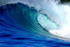 Blue surfing wave. Blue surf wave on tropical island reef Stock Photography