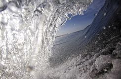 Blue surfing wave view from inside the tube Royalty Free Stock Image