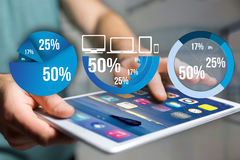 Blue survey graph interface with business theme going out a smar. View of Blue survey graph interface with business theme going out a smartphone - Technology Royalty Free Stock Images