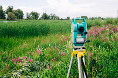 Blue surveying   equipment total station on a background of meadow Royalty Free Stock Photos