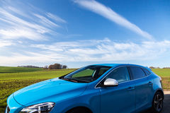 Blue Suv Near the Green Grass Field Royalty Free Stock Images