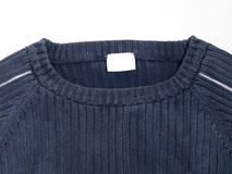 Blue sweater with label Stock Image