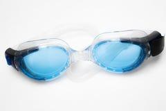 Blue swim goggles on white background. Close up of blue swim goggles on white background Royalty Free Stock Photos
