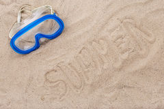 Blue swimming mask on the beach Royalty Free Stock Photos