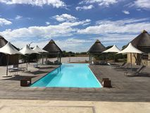 Blue Swimming Pool in African Desert Royalty Free Stock Photography