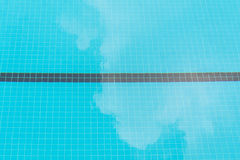 Blue swimming pool bottom and white cloud reflection Royalty Free Stock Photography