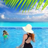Blue swimming pool caribbean view mother daughter Royalty Free Stock Images