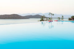 Blue swimming pool on Crete. Blue swimming pool with Mirabello Bay view on Crete, Greece Royalty Free Stock Images