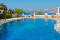 Blue swimming pool in Fira on island of Santorini Stock Photography