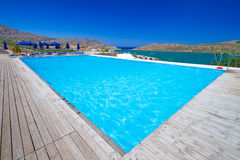 Blue swimming pool in Greece. Blue swimming pool at Mirabello Bay in Greece Royalty Free Stock Images