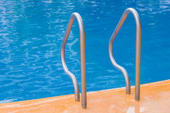 blue swimming pool at hotel with stair Stock Photography