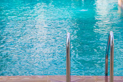 blue swimming pool at hotel with stair Stock Images